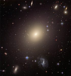 There are different types of galaxies: Milky Way is a spiral galaxy, the galaxy on the picture, ESO 325-G004, is an elliptical one.
